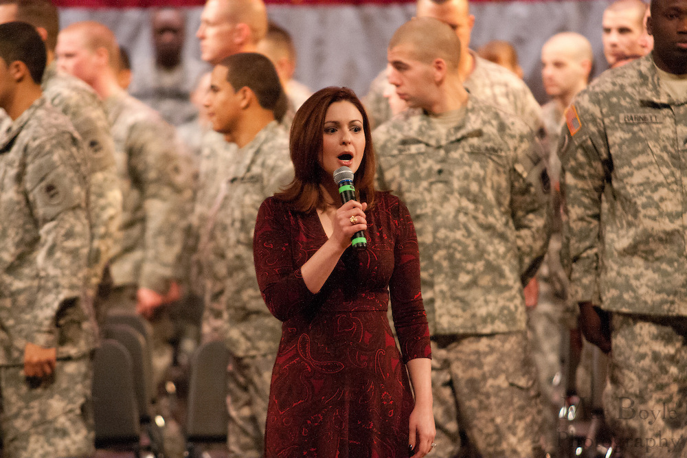 Ms. Jill Horner, Miss New Jersey 2000, sings the national anthem at the 119th Combat Sustainment Support Battalion deployment ceremony  at Rowan University in Glassboro, NJ on Saturday December 18, 2010. (photo / Mat Boyle).