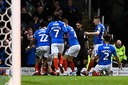 Goal - Ronan Curtis (11) of Portsmouth is mobbed as he celebrates after he scores a goal to give a 1-0 lead during the EFL Sky Bet League 1 match between Portsmouth and Ipswich Town at Fratton Park, Portsmouth, England on 21 December 2019.