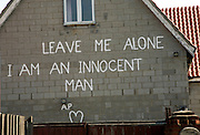 Sign painted on house 'Leave Me Alone I Am An Innocent Man'