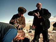 Anthropologist Ted Callahan getting a head shave from Roshan, son of the Khan. <br /> Winter expedition through the Wakhan Corridor and into the Afghan Pamir mountains, to document the life of the Afghan Kyrgyz tribe. January/February 2008. Afghanistan