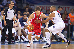 Rok Stipcevic of Croatia vs Eric Gordon of USA during to the Preliminary Round - Group B basketball match between National teams of USA and Croatia match at 2010 FIBA World Championships on August 28, 2010 at Abdi Ipekci Arena in Istanbul, Turkey.  (Photo by Vid Ponikvar / Sportida)