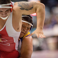 Roswell Coyote Eddie Macias, left, and Kirtland Central Bronco Jyden Dodge grapple during the 2018 New Mexico High School Wrestling Championship at the Santa Ana Star Center in Rio Rancho Saturday.