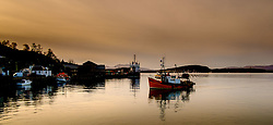 A fishing boat arrives in the harbour at Oban, Highlands of Scotland<br /> <br /> (c) Andrew Wilson | Edinburgh Elite media