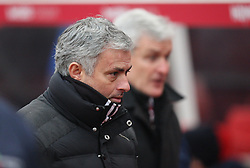 Manchester United manager Jose Mourinho (L) and Stoke City manager Mark Hughes - Mandatory by-line: Jack Phillips/JMP - 21/01/2017 - FOOTBALL - Bet365 Stadium - Stoke-on-Trent, England - Stoke City v Manchester United - Premier League