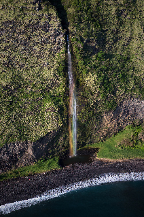 Liquid Rainbow! This is a coastal waterfall, just north of Waipio Valley. The refraction of early morning sunlight through the falling water droplets created an amazing rainbow within!