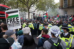 London, UK. 11th May, 2021. Thousands of people attend an emergency protest in solidarity with the Palestinian people organised outside Downing Street by Palestine Solidarity Campaign, Friends of Al Aqsa, Stop The War Coalition and Palestinian Forum in Britain. The rally took place in protest against Israeli air raids on Gaza, the deployment of Israeli forces against worshippers at the Al-Aqsa mosque during Ramadan and attempts to forcibly displace Palestinian families from the Sheikh Jarrah neighbourhood of East Jerusalem.