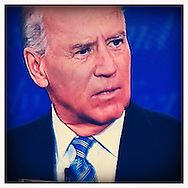 The Vice Presidential debate on CNN taken from a flat screen plasma TV, by a iPhone 4 camera phone with the Hipsatmatic app.