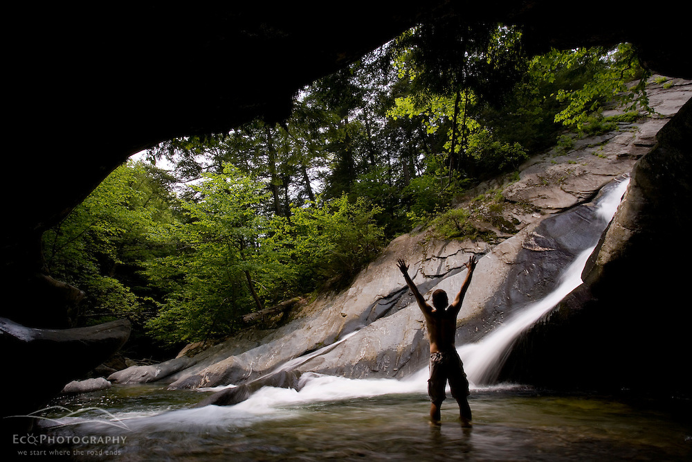 A man enjoys a pool of water at the base of Hamilton Falls in Vermont's Jamaica State Park.  Green Mountains.  Cobb Brook, a West River tributary.