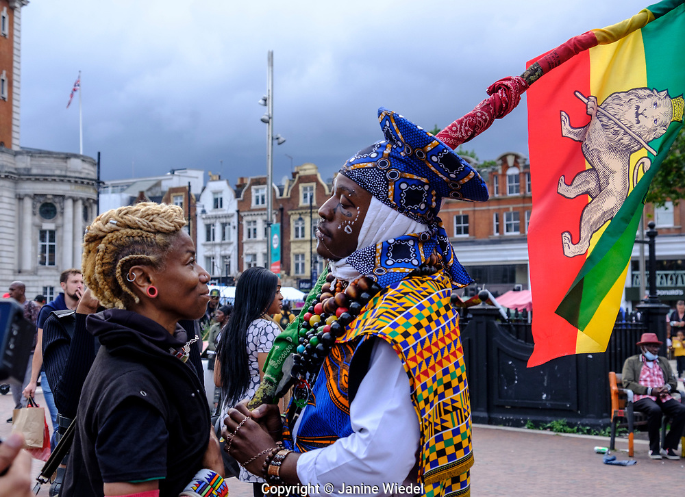 Rastafarian in traditional dress at annual Reparations Revolution event on Afrikan Emancipation Day in Windrush Square Brixton 2021.