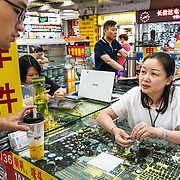 A woman selling high-tech parts in Shenzhen, a hightech hub in southern China.