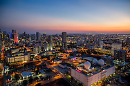Aerial view of downtown Miami looking west at twilight.