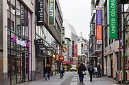 Corona Lockdown, December 16th. 2020. Only few people on shopping street Hohe Strasse, usually visited by thousands of people, Cologne, Germany.<br /> <br /> Corona Lockdown, 16. Dezember 2020. Nur sehr wenige Menschen in der Fussgaengerzone Hohe Strasse, normalerweise von tausenden Menschen besucht,  Koeln, Deutschland.