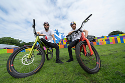 Edinburgh, Scotland, UK. 2 August 2019. Professional Trials riders Danny MacAskill and Duncan Shaw perform tricks on the Meadows. Danny MacAskill's Drop & Roll Live is a main highlight of this year's Underbelly Circus Hub programme. Pictured Duncan Shaw left and Danny MacAskill Iain Masterton/Alamy Live News