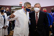 27 MARCH 2021 - DES MOINES, IOWA: Dr. YOGESH SHAH, Chief Medical Officer and Vice President of Medical Affairs at Broadlawns Medical Center, talks to TOM VILSACK, the Secretary of Agriculture for President Joe Biden, during a COVID-19 (Coronavirus) vaccination clinic at Corinthian Baptist Church in Des Moines, Saturday. The clinic was organized by Broadlawns Medical Center and the United Way and provided more than 1,100 shots to Des Moines area residents. The clinic was a part of an effort to reach communities of color in Iowa, who are vaccinated at rates below the state average.      PHOTO BY JACK KURTZ