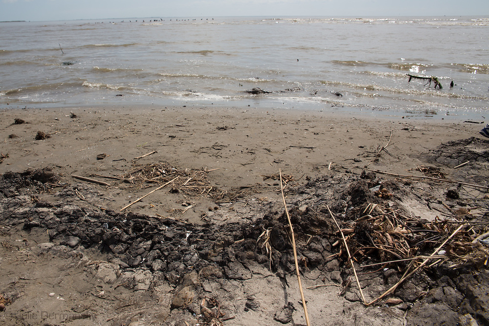 March 31, 2015,  Five years after the BP oil spill, A tar matt on East Grande Terre Isalnd, a barrier island in Plaquemines Parish that was hit hard by the BP oil spill in 2010.<br /> BP recently led an effort to clean up a tar mat uncovered on the same area of the beach a couple weeks before that was connected to the BP oil spill.