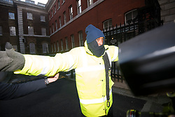 © Licensed to London News Pictures. 12/02/2018. London, UK. Security form Department for International Development attempt to stop photogra0phers form photographing Oxfam CEO, Mark Goldring as he leaves the Department for International Development following a meeting with Secretary of State for International Development Penny Mordaunt to discuss claims of sexual misconduct by its aid workers. Mordaunt wants to hear more from Oxfam about allegations its staff used prostitutes in Haiti in 2011. Photo credit: Ben Cawthra/LNP