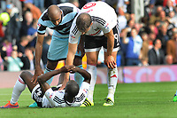 Football - 2016 /2017 Championship - Fulham vs Queens Park Rangers<br /> <br /> Sone Aluko of Fulham is consoled after missing his injury time penalty kick which would have levelled the scoring at 2 -2 at Craven Cottage<br /> <br /> Credit : Colorsport / Andrew Cowie