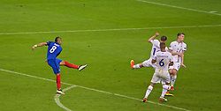 PARIS, FRANCE - Sunday, July 3, 2016: France's Dimitri Payet scores the third goal against Iceland during the UEFA Euro 2016 Championship Semi-Final match at the Stade de France. (Pic by Paul Greenwood/Propaganda)