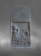 Neo Hittite basalt funerary stele with an aramean inscription from Neirab or Tell Afis, Syria, 7th cent BC. Louvre Museum. Grey background