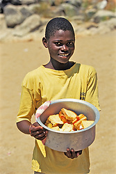 Local Boy On Nkhata Bay Beach Selling Sandwiches