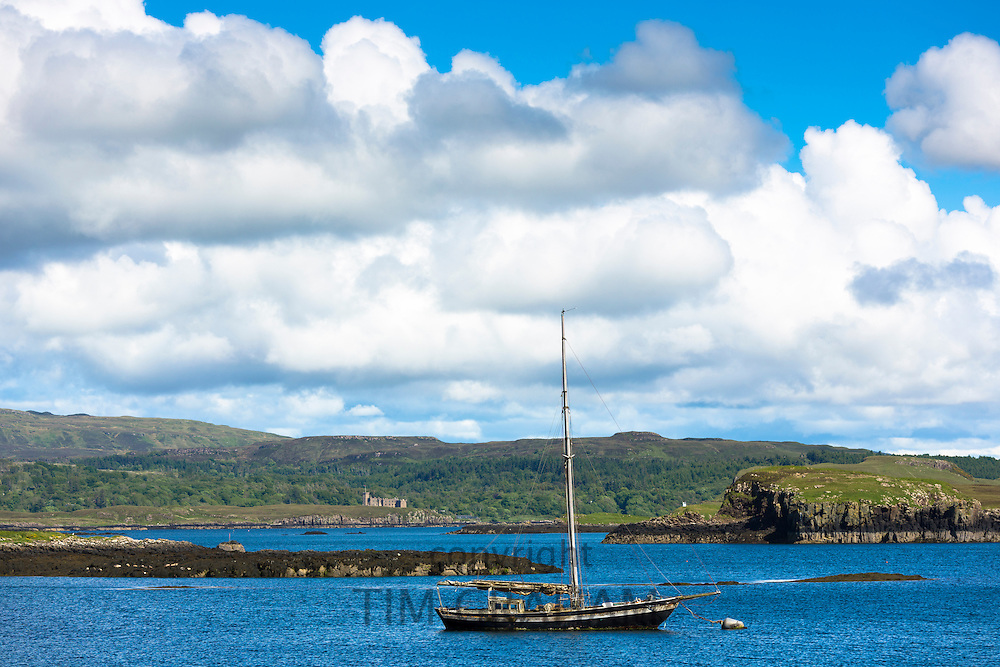 Solitary sailboat fishing boat on Dunvegan Loch, the Isle of Skye in Scotland
