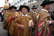 Feast of Corpus Christi. Among the various figures in traditional costume stand out players of pututu, a large shell that was already musical instrument in Inca era