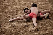 Young Indian boys practicing the ancient sport of Kushti wrestling