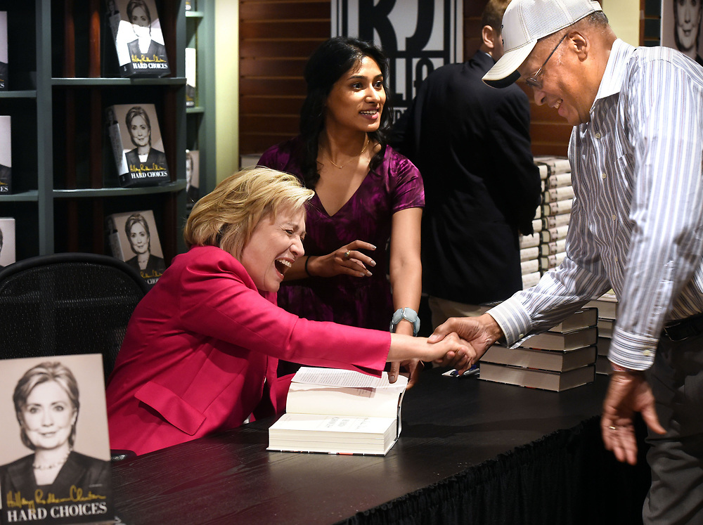 """(Mara Lavitt — New Haven Register) <br /> July 19, 2014 Madison<br /> R.J. Julia Booksellers in Madison hosted a Hillary Clinton book signing for her book """"Hard Choices."""" At least a thousand people got their copies signed. Clinton greets James Thomas, senior fellow at the Yale Law School.<br /> mlavitt@newhavenregister.com"""