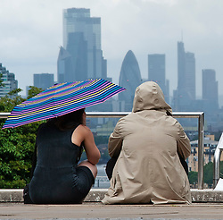 ©Licensed to London News Pictures 02/07/2020     <br /> Greenwich, UK. Dark rain clouds over London. People out and about in Greenwich Park, Greenwich, London today as the Coronavirus lockdown is eased. The weather continues to be unsettled with heavy rain and sunshine. Photo credit: Grant Falvey/LNP