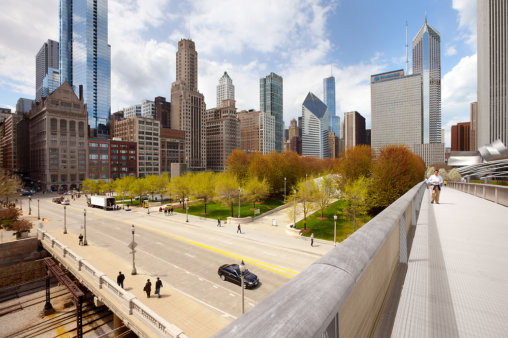 Chicago, Illinois, United States - Cityscape of skyscrapers at downtown with Nichols Bridgeway and Millennium Park.