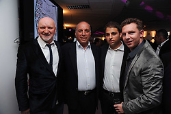 Left to right, SIR TOM HUNTER, DAVID REUBEN, JAMIE REUBEN and NICK CANDY at The Reuben Foundation and Virgin Unite Haiti Fundraising dinner held at Altitude 360 in Millbank Tower, London on 26th May 2010.