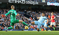 David De Gea of Manchester United makes save from Sergio Aguero of Manchester City - Barclays Premier League - Manchester City vs Manchester Utd - Etihad Stadium - Manchester - England - 2nd November 2014  - Picture David Klein/Sportimage