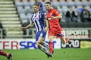 Max Power (Wigan) and Rory Donnelly (Gillingham) during the Sky Bet League 1 match between Wigan Athletic and Gillingham at the DW Stadium, Wigan, England on 7 January 2016. Photo by Mark P Doherty.