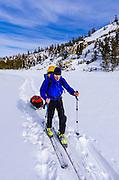Backcountry skier, John Muir Wilderness, Sierra Nevada Mountains, California  USA
