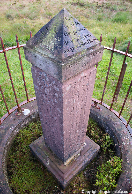 Allan's Cairn or Covenanters' Monument. George Allan and Margaret Gracie were shot on the Fawns of Altry, a natural feature once used for open-air conventicles. Their inscribed sandstone memorial lies on the junction of three parish boundaries, Southern Uplands, Scotland