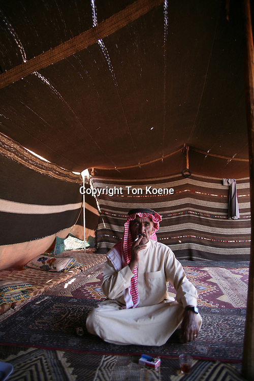 A Bedouin man smoking in a tent, Jordan