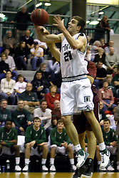 16 December 2006: Andrew Freeman grabs a rebound. The University of Chicago Maroons upset  the Illinois Wesleyan Titans 64 - 60 at the Shirk Center in Bloomington Illinois.<br />