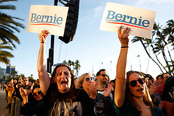 March 22, 2019 - San Diego, California, U.S. - AUTUMN WHEELER, left, and ASHLEE PATTERSON hold signs as they cheer while listening to U.S. Senator and Democratic candidate for president Bernie Sanders speak during a campaign rally at Waterfront Park in San Diego on Friday. (Credit Image: © Hayne Palmour IV/San Diego Union-Tribune via ZUMA Wire)