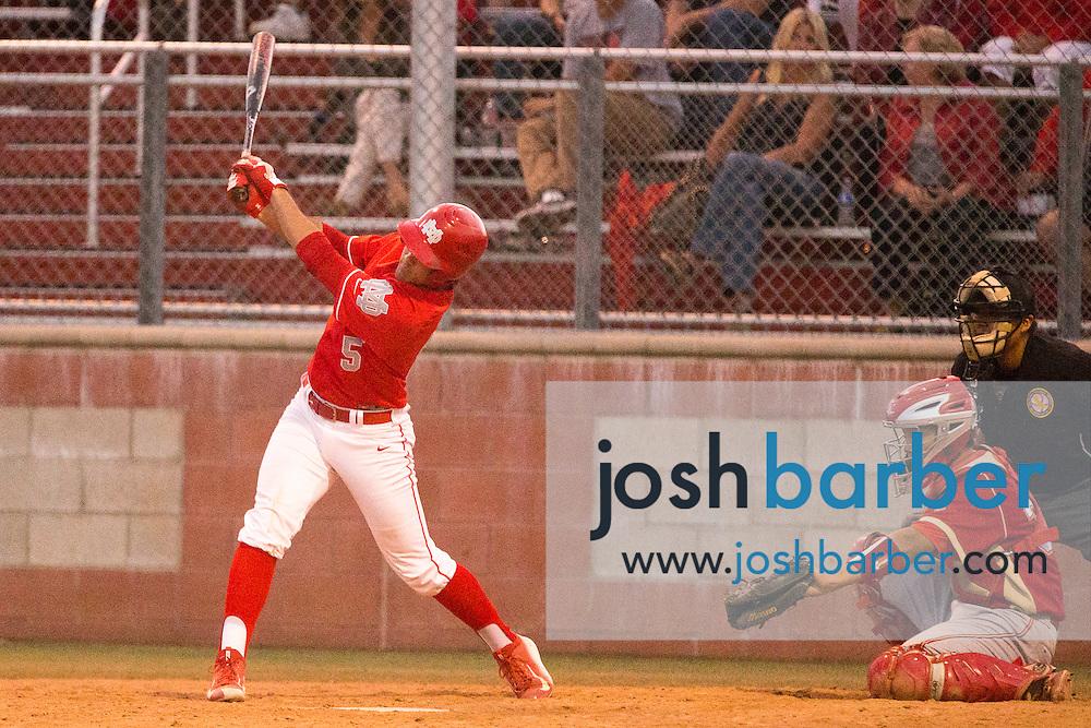 Orange Lutheran's Garrett Mitchell (5) batting during a Trinity League game at Mater Dei High School on Friday, May 1, 2015 in Santa Ana, Calif. (Photo/Josh Barber)