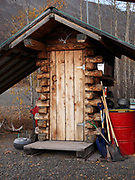 Log outhouse with oversized roof, Meekin's Air Service, Majestic Valley, Alaska.