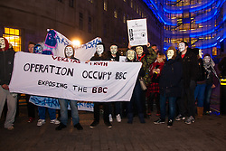 "London, December 23rd 2014. Online activism group Anonymous march through London from the City to the BBC's HQ on Great Portland Street in protest against alleged biases and coverups of a ""paedophile ring"". PICTURED: The small group of protesters pose for a group shot outside the BBC"
