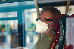 Edinburgh, Scotland, UK. 3 July, 2020. Shops and businesses are re-opening and getting back to normal in Scotland after coronavirus lockdown on such businesses were relaxed this week. Passenger on bus wears face covering.  Iain Masterton/Alamy Live News