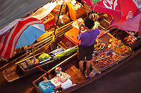 The traditional Thai riverside way of life continues in Amphawa.  Most of the action takes place along the waterfront walkways of Amphawa Canal, a  tributary of the Mae Khlong River. Every weekend Thais flock to the Amphawa Floating Market. Old  wooden houses and shopfronts retain some of their original charm.  Eating is a major activity at Amphawa -  there are many vendors in boats preparing an array of foods right in front of you. Seafood is the big thing here as the ocean is nearby and Amphawa is first and foremost a fishermans community.