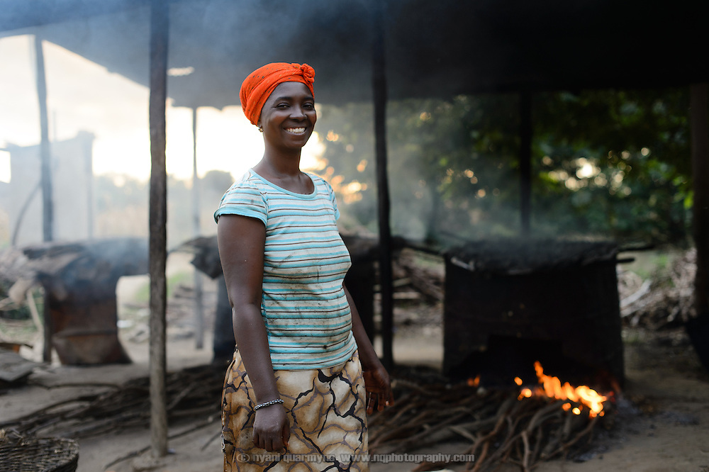 Patience Diaba prepares smoked fish at her home in Dabala Junction in the Volta Region of Ghana and sells it at a nearby market. Her participation in a 'Banking on Change' Village Savings and Loan Association (VSLA) has helped her expand her business.