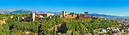 """Panoramic view of the Moorish Islmaic Alhambra Palace comples and fortifications. Granada, Andalusia, Spain. . The Alhambra is a palace and fortress complex located in Granada, Andalusia, Spain. It was originally constructed as a small fortress in 889 CE on the remains of ancient Roman fortifications. The Alhambra was renovated and rebuilt in the mid-13th century by the Arab Nasrid emir Mohammed ben Al-Ahmar of the Emirate of Granada, who built its current Alhambra palace and walls. The Alhambra was converted into a royal palace in 1333 by Yusuf I, Sultan of Granada. The decoration of The Alhambra consists for the upper part of the walls, as a rule, of Arabic inscriptions—mostly poems by Ibn Zamrak and others praising the palace—that are manipulated into geometrical patterns with vegetal background set onto an arabesque setting (""""Ataurique""""). Much of this ornament is carved stucco (plaster) rather than stone. Tile mosaics (""""alicatado"""") of The Alhambra, with complicated mathematical patterns (""""tracería"""", most precisely """"lacería""""), are largely used as panelling for the lower part. .<br /> <br /> Visit our SPAIN HISTORIC PLACXES PHOTO COLLECTIONS for more photos to download or buy as wall art prints https://funkystock.photoshelter.com/gallery-collection/Pictures-Images-of-Spain-Spanish-Historical-Archaeology-Sites-Museum-Antiquities/C0000EUVhLC3Nbgw <br /> .<br /> Visit our ISLAMIC HISTORICAL PLACES PHOTO COLLECTIONS for more photos to download or buy as wall art prints https://funkystock.photoshelter.com/gallery-collection/Islam-Islamic-Historic-Places-Architecture-Pictures-Images-of/C0000n7SGOHt9XWI"""