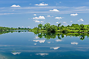 cloud reflection in St. Lawrence River<br /> Thousand Islands<br /> Ontario<br /> Canada