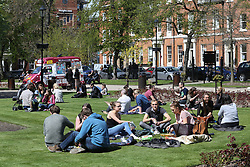 © Licensed to London News Pictures. 04/05/2016. Leeds, UK. City workers enjoy the bright warm sunshine during their lunch breaks in Leeds, West Yorkshire. Britain is experience warmer weather this week with temperatures to rise to 23 degrees celsius this weekend. Photo credit : Ian Hinchliffe/LNP