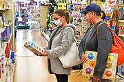 Diane Lucash of Freeburg (left) and her sister Tammy Walker of Belleville shopping for toys for grandchildren at Ben's store in downtown Belleville on Friday November 27, 2020. <br /> Photo by Tim Vizer