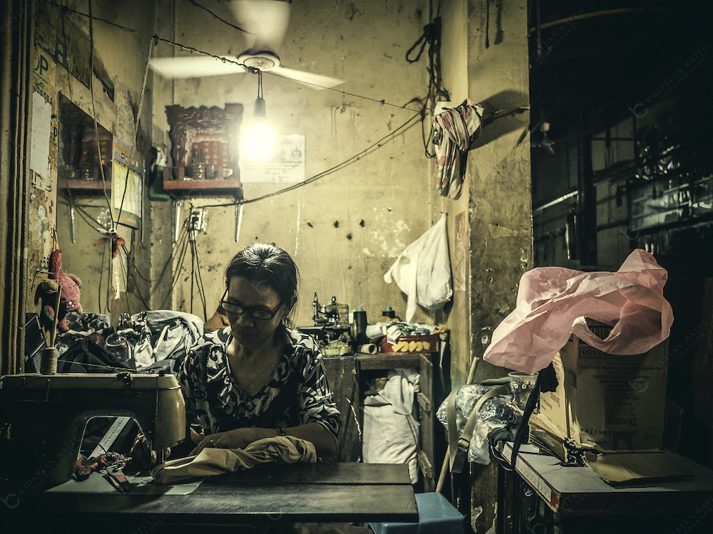 Woman sewing in workshop at Siem Reap Cambodia