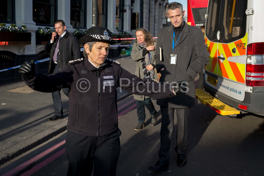 The morning after the terrorist attack at Fishmongers Hall on London Bridge, in which Usman Khan a convicted, freed terrorist killed 2 during a knife a attack, then subsequently tackled by passers-by and shot by armed police - Met Police Commissioner Cressida Dick greets a local lady before touring Borough Market, on 30th November 2019, in London, England.